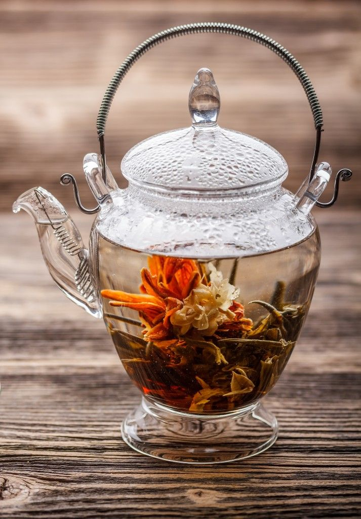 blooming _ flowering tea in a clear glass teapot